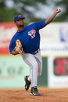Pulaski Blue Jays starting pitcher Francisco Mateo winds up to deliver the ball to the plate versus the Burlington Indians at Burlington Athletic Park in Burlington, NC, Saturday, July 29, 2006.  The Indians defeated the Blue Jays by the score of 8-4.