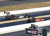 Oct 14, 2019; Concord, NC, USA; NHRA top fuel driver Billy Torrence (left) alongside Brittany Force during the Carolina Nationals at zMax Dragway. Mandatory Credit: Mark J. Rebilas-USA TODAY Sports