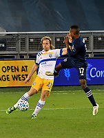 KANSAS CITY, KS - NOVEMBER 22: Florian Jungwirth #23 of the San Jose Earthquakes and Gadi Kinda #17 of Sporting KC battle for the ball before a game between San Jose Earthquakes and Sporting Kansas City at Children's Mercy Park on November 22, 2020 in Kansas City, Kansas.