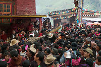 Arhat clowns act as disciplinarians at the Cham dances, Katok Dorjeden Monastery - Kham, (eastern, Tibet), Sichuan, China