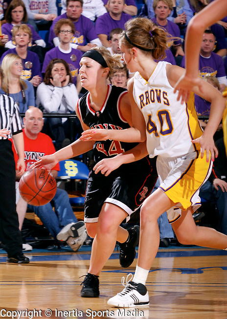 BROOKINGS, SD - March 14th, 2009 : Jayme Knochenmus drives down court while being closely followed by Watertown's Abby Winkels during their game Saturday evening in the 2009 State AA Girls Basketball Championship game in Frost Arena on the campus of South Dakota State University in Brookings, SD. (Photo By Ty Carlson/Inertia)