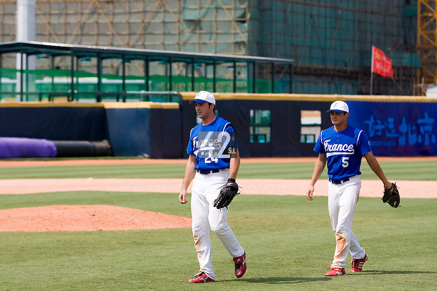 23 August 2007: #24 Gaspard Fessy and #5 Kenji Hagirawa are seen after the France 8-4 victory over Czech Republic in the Good Luck Beijing International baseball tournament (olympic test event) at the Wukesong Baseball Field in Beijing, China.