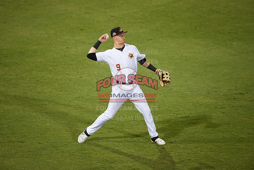 Mesa Solar Sox left fielder Greg Deichmann (9), of the Oakland Athletics organization, throws to the infield during an Arizona Fall League game against the Peoria Javelinas on September 21, 2019 at Sloan Park in Mesa, Arizona. Mesa defeated Peoria 4-1. (Zachary Lucy/Four Seam Images)
