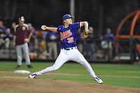 Clemson Tigers pitcher Clate Schmidt #32 delivers a pitch during a game against the Florida State Seminoles at Doug Kingsmore Stadium on March 22, 2014 in Clemson, South Carolina. The Seminoles defeated the Tigers 4-3. (Tony Farlow/Four Seam Images)