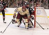 Johnny Gaudreau (BC - 13), Josh Manson (NU - 3) - The Boston College Eagles defeated the Northeastern University Huskies 6-3 for their fourth consecutive Beanpot championship on Monday, February 11, 2013, at TD Garden in Boston, Massachusetts.