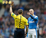 Kenny Miller makes a point to referee Crawford Allan