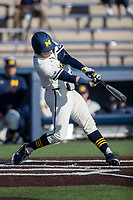 Michigan Wolverines first baseman Jimmy Obertop (8) hits a home run to deep centerfield during the NCAA baseball game against the Illinois Fighting Illini at Fisher Stadium on March 19, 2021 in Ann Arbor, Michigan. Illinois won the game 7-4. (Andrew Woolley/Four Seam Images)