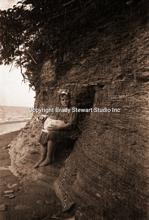 North East PA: Helen Stewart and Peppy watching the rain on Lake Erie. During the early 1900s, the Stewart family vacationed on Lake Erie near North East Pennsylvania. Since hotels and motels were non-existent, camping was the only viable option for a large number of vacationers