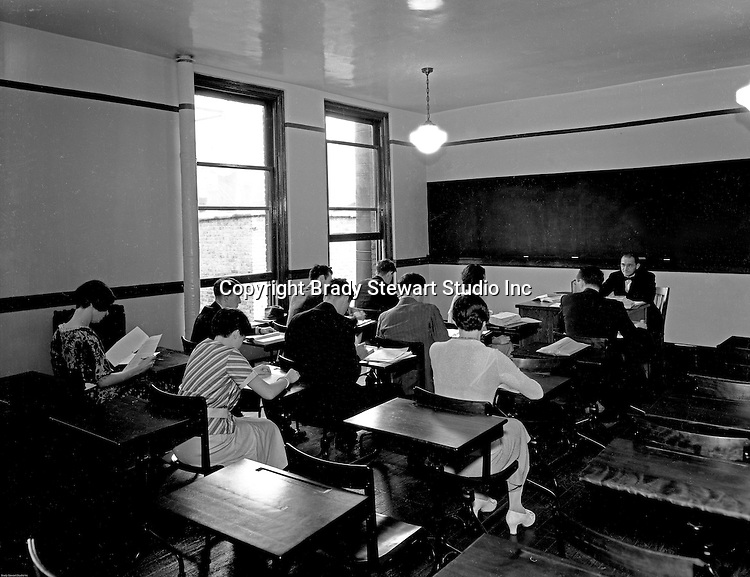 Pittsburgh PA:   Students taking a test in a college classroom.<br /> \Brady Stewart was hired to photography the campus, classrooms and offices for a publication to increase enrollment at the Catholic University.