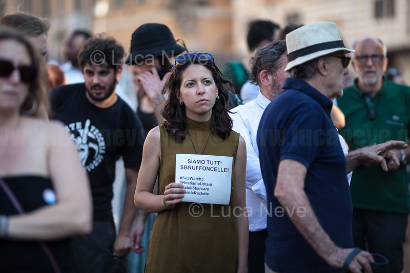 """Rome, 27/06/2019. Today, an emergency demonstration in support and solidarity with the migrants and the crew on board of the Sea-Watch 3 Ship was held in Piazza dell'Esquilino. The rally, organised by """"Rete Restiamo Umani"""" (1.) and """"Mediterranea Roma"""" (2.) and supported by other organizations, saw protesters, activists and members of the public protesting against the decision of the Interior Minister Matteo Salvini (Leader of Lega - League Party ) to keep closed the Italian ports to NGO vessels. As a result, the Sea-Watch 3 ship of the humanitarian German group Sea Watch (flying a Dutch flag) (3.) with its rescued 42 passengers (saved on the 12th of June) has remained on stand-by in front of the port of the island of Lampedusa (Sicily) since the 15th June 2019, without the possibility to disembark the exhausted people on a safe port. Yesterday, the Captain of the NGO vessel, Carola Rackete, tried to enter the port without authorization citing an emergency situation on board but the attempt was blocked by the Guardia di Finanza vassels. Today the captain was formally put under investigation by a prosecutor in Sicily. The demonstration ended peacefully with a march to Piazza Vittorio Emanuele II.<br /> <br /> Footnotes and Links:<br /> 1. https://www.facebook.com/ReteRestiamoUmani/<br /> 2. https://www.facebook.com/Mediterranearoma<br /> 3. https://sea-watch.org<br /> For more info about the event please click here: https://www.facebook.com/events/907298442941378/"""