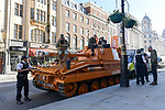 Pictured:  Police pull over James Haskell as he rides ontop of the Grenade® tank around Central London in protest of #KeepingGymsOpen during the second Coronavirus lockdown that starts tomorrow in England.<br /> <br /> A bright orange tank driven by England rugby star James Haskell headed to Parliament Square today and caused a ruckus as it was stopped by police.  The former international was joining performance nutrition brand Grenade in protesting gyms and leisure centres being classified as 'non-essential' under new lockdown regulations.<br /> <br /> There were a reported 22 million visits to gyms after they reopened in July, with just 78 Covid cases being tracked to these locations.  With England set to return to a nationwide lockdown from tomorrow (Thursday November 4) these leisure facilities will once again be forced to close, not being classed as 'essential'. SEE OUR COPY FOR DETAILS<br /> <br /> © Solent News & Photo Agency<br /> UK +44 (0) 2380 458800