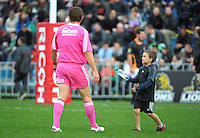 A ballboy delivers water to the referee during the rugby union match between the Wellington Lions and Canterbury at Hutt Recreation Ground, Wellington, New Zealand on Friday, 9 August 2013. Photo: Dave Lintott / lintottphoto.co.nz