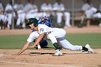 Oakland Athletics third baseman Chad Pinder (12) slides home avoiding the tag of catcher Ben Carhart (5) during an Instructional League game against the Chicago Cubs on October 16, 2013 at Papago Park Baseball Complex in Phoenix, Arizona.  (Mike Janes/Four Seam Images)