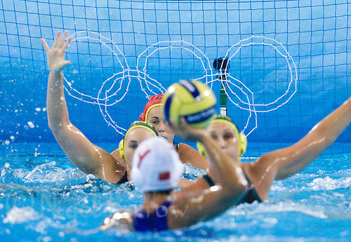 17 AUG 2008 - BEIJING, CHN - Australian goalkeeper Alicia McCormack (AUS) watches the build up of a Chinese attack - Australia (green and yellow) v China (white) - Beijing Olympics. (PHOTO (C) NIGEL FARROW) *** IOC RULES APPLY ON USAGE ***