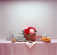 Side board with china, silverware, flowers & pastry