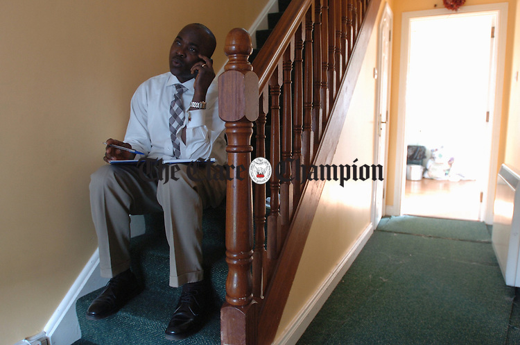 Ennis Town Council election candidate Matthew Taiwo at home in Dun Na Ri with his son Tommy. Photograph by John Kelly.