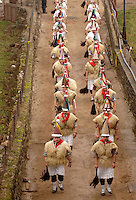 ITUREN, NAVARRE - JANUARY 30: A group of 'Zanpantzar', people dressed in sheep fur and big cowbells tied to their back, march across Ituren village with the 'artza' (Center) during an ancient traditional carnival on January 30, 2006. Zanpantzar´s march trough Ituren farmhouses and streets sounding their cowbells to wake up the earth for a good new farmer year and keep far away all bad spirits . Photo by Ander Gillenea