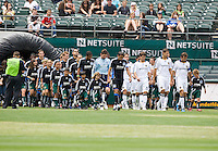 June 20, 2009: San Jose Earthquakes and Los Angeles Galaxy walk out to the field with kids before the start of the game at Coliseum in Oakland, California. San Jose Earthquakes defeated Los Angeles, 2-1