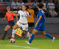 USWNT forward (12) Lauren Cheney looks to get past Japanese defender (4) Azusa Iwashimizu while playing at Worker's Stadium.  The USWNT defeated Japan, 4-2, during the semi-finals of the Beijing 2008 Olympics in Beijing, China.