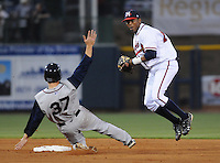 9 April 2008: Javier Guzman (13) of the Mississippi Braves tags out Greg Thomson (37) of Mobile BayBears during the Braves' home opener at Trustmark Park in Pearl, Miss. Photo by:  Tom Priddy/Four Seam Images