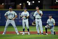 (L-R) Southern Maryland Blue Crabs infielders Josh McAdams (7), Michael Baca (12), Alex Crosby (15), and Kent Blackstone (6) wait on a pitching change during the game against the High Point Rockers at Truist Point on June 18, 2021, in High Point, North Carolina. (Brian Westerholt/Four Seam Images)
