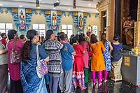 Worshipers Waiting for Priest to Emerge from Inner Shrine, Kuil Sri Krishna Hindu Temple, Kuala Lumpur, Malaysia.