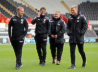 Bournemouth manager Eddie Howe (R) with colleagues on the pitch before the Barclays Premier League match between Swansea City and Bournemouth at the Liberty Stadium, Swansea on November 21 2015