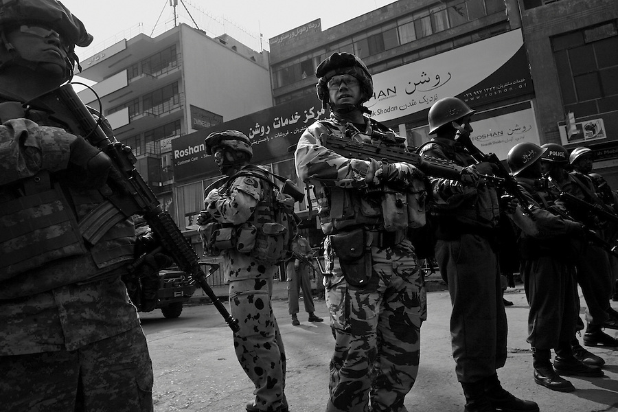 Afghan and NATO security forces respond after a suicide bomber strikes the Afghan Ministry of Information and Culture on Thursday October 10, 2008.