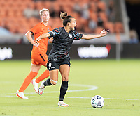 Mallory Pugh #9 of the Chicago Red Stars looks to pass the ball during a game between Chicago Red Stars and Houston Dash at BBVA Stadium on September 10, 2021 in Houston, Texas.