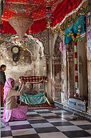 India, Dehradun.  Visitor at the Durbar Shri Guru Ram Rai Ji Maharaj Sikh Temple, built in 1707, Takes a Picture of the Interior through the Entrance Doorway.