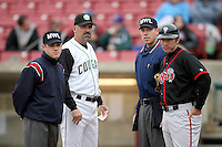 April 29, 2009: L to R: Umpire Charles Billington, Cougars Manager Steve Scarsone, Umpire Luke Hamilton, and Lugnuts Manager Clayton McCullough discuss the ground rules before a game at  Elfstrom Stadium in Geneva, IL.  Photo by: Chris Proctor/Four Seam Images