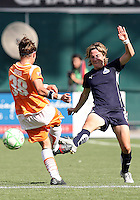 Sonia Bompastor #8 of Washington Freedom flicks the ball away from Julianne Sitch #38 of Sky Blue FC during a WPS match at RFK Stadium on May 23, 2009 in Washington D.C.