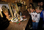 Visitors to the memorial shrine to Princess Diana and Dodi Fayed in the basement of Harrods department store, London 1998.