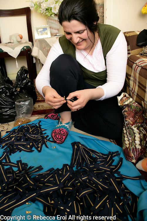 Turkish woman fixes zips for the textiles industry at home, Istanbul, Turkey