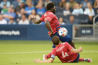 KANSAS CITY, KS - JULY 31: Ema Twumasi #22 and Bressan #4 FC Dallas try to clear the ball during a game between FC Dallas and Sporting Kansas City at Children's Mercy Park on July 31, 2021 in Kansas City, Kansas.