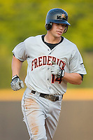 Brandon Waring #14 of the Frederick Keys rounds the bases after hitting a home run at Wake Forest Baseball Stadium August 9, 2009 in Winston-Salem, North Carolina. (Photo by Brian Westerholt / Four Seam Images)