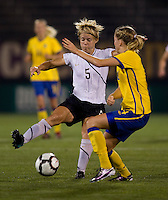 Lori Lindsey (5) of the USWNT tries to control the ball in front of Linda Sembrant (4) of Sweden at Rentschler Field in East Hartford, Connecticut.  The USWNT defeated Sweden, 3-0.