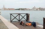 Venice Italy 2009. Tourist couple asleep , The church of San Giorgio Maggiore ( left ) The churh of  on La Giudecca. Canale della Giudecca.