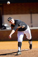 Wake Forest Demon Deacons starting pitcher Mark McCoy (41) warms up in the bullpen prior to the game against the Youngstown State Penguins at Wake Forest Baseball Park on February 24, 2013 in Winston-Salem, North Carolina.  The Demon Deacons defeated the Penguins 6-5.  (Brian Westerholt/Four Seam Images)