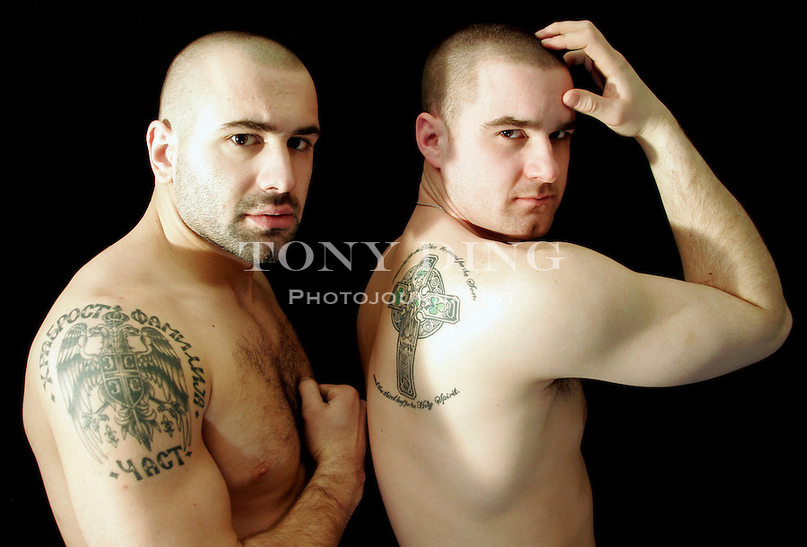 Michigan senior hockey players Milan Gajic, left, and Michael Woodford show-off their tattoos they got together in Ann Arbor. Picture taken on Thursday, March 31, 2005.  (Photo by TONY DING / The Michigan Daily)