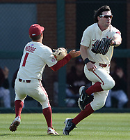 Arkansas second baseman (1) collides Wednesday, April 7, 2021, with right fielder Cayden Wallace as Wallace catches a fly ball during the first inning of the Razorbacks' 10-3 win over UALR at Baum-Walker Stadium in Fayetteville. Visit nwaonline.com/210408Daily/ for today's photo gallery. <br /> (NWA Democrat-Gazette/Andy Shupe)
