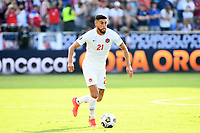 KANSAS CITY, KS - JULY 18: Jonathan Osorio #21 of Canada during a game between Canada and USMNT at Children's Mercy Park on July 18, 2021 in Kansas City, Kansas.