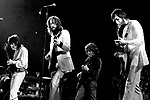 Eric Clapton 1973 Rainbow Theatre comeback concert here with Pete Townshend and Ron Wood. <br /> © Chris Walter