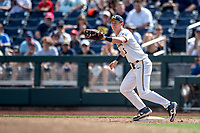 Michigan Wolverines first baseman Jimmy Kerr (15) during Game 1 of the NCAA College World Series against the Texas Tech Red Raiders on June 15, 2019 at TD Ameritrade Park in Omaha, Nebraska. Michigan defeated Texas Tech 5-3. (Andrew Woolley/Four Seam Images)