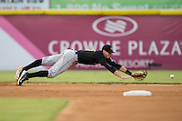 West Virginia Power shortstop Kevin Newman (5) dives for the baseball during the game against the Hickory Crawdads at L.P. Frans Stadium on August 15, 2015 in Hickory, North Carolina.  The Power defeated the Crawdads 9-0.  (Brian Westerholt/Four Seam Images)