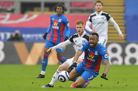 Jordan Ayew of Crystal Palace is fouled by Harrison Reed of Fulham during the Premier League behind closed doors match between Crystal Palace and Fulham at Selhurst Park, London, England on 28 February 2021. Photo by Vince Mignott / PRiME Media Images.