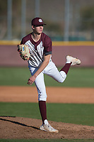 Mountain Ridge Mountain Lions starting pitcher Matthew Liberatore (32) follows through on his delivery during a game against the Boulder Creek Jaguars at Mountain Ridge High School on February 28, 2018 in Glendale, Arizona. Liberatore collected 14 strikeouts in his first appearance of the spring, leading the Mountain Lions to a 6-3 conference victory. (Zachary Lucy/Four Seam Images)