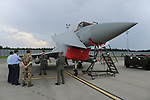 British Royal Air Force airmen showcase one of the Typhoon fight jets flying as part of NATO's Baltic Air Policing mission to a group of visiting members of Parliament at Ämari Air Force Base, Estonia on June 7, 2019.