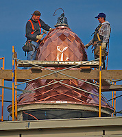 Workers install copper panels on the cupola atop the historic Holmes Hotel in Uptown Westerville. The new fixture returns the hotel to a splendor not seen for 119 years. Photo Copyright Gary Gardiner.