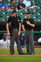 Umpires Alex Ransom and Lewis Williams during a game between the Tennessee Smokies and Montgomery Biscuits on May 25, 2015 at Riverwalk Stadium in Montgomery, Alabama.  Tennessee defeated Montgomery 6-3 as the game was called after eight innings due to rain.  (Mike Janes/Four Seam Images)